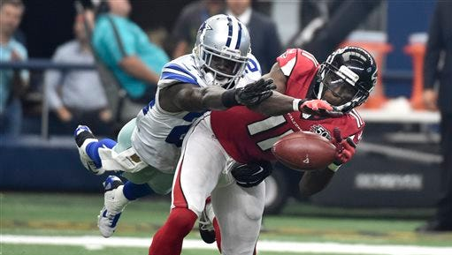Dallas Cowboys cornerback Morris Claiborne (24) breaks up a pass intended for Atlanta Falcons' Julio Jones (11) in the second half of an NFL football game on Sunday.
