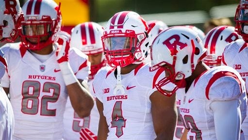 Rutgers wide receiver Leonte Carroo (4) waits with his teammates to take the field for pregame warmups before an NCAA college football game against Indiana, Saturday, Oct. 17, 2015, in Bloomington, Ind. (AP Photo/Doug McSchooler)