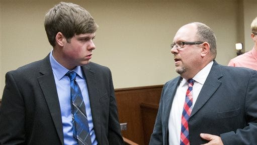 Zach Anderson, left, talks to his attorney father Les Anderson after being resentenced Monday, Oct. 19, 2015, in St. Joseph, Mich.