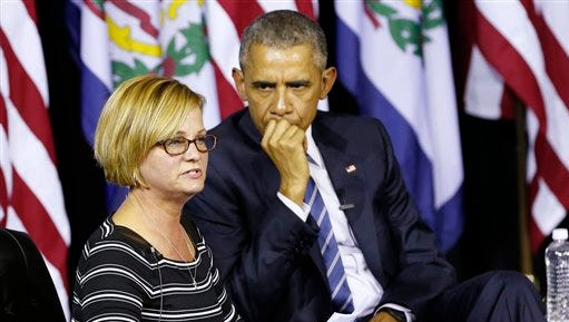 President Obama listens as Cary Dixon speaks of her struggles with her son's addiction during an event at the East End Family Resource Center in Charleston, W.Va., Wednesday, Oct. 21, 2015.  Obama was in Charleston to to host a community discussion on the prescription drug abuse and heroin epidemic.  (AP Photo/Steve Helber)