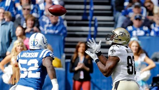 New Orleans Saints tight end Benjamin Watson (82) makes a catch on a fake field goal in front of Indianapolis Colts inside linebacker D'Qwell Jackson (52) in the first half of an NFL football game in Indianapolis, Sunday.