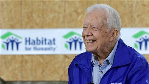In this Nov. 1 photo, former President Jimmy Carter is interviewed at a Habitat for Humanity project site in Memphis. Carter said it's too soon to tell whether treatment he received for his brain cancer has been effective, but that he hasn't been uncomfortable or ill while receiving rounds of immune-boosting drugs.