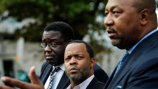 Local pastors including, from left, Noel Hutchinson, Stacy Spencer, and Keith Norman, who are affiliated with the NAACP, speak to the media Tuesday after Shelby County District Attorney Amy Wierich announced that a grand jury declined to indict Memphis Police Officer Connor Schilling in the July 17 death of Darrius Stewart, in Memphis.