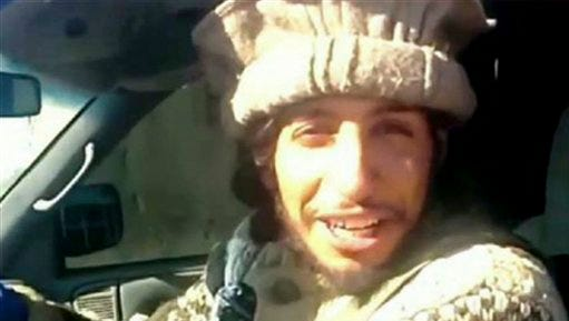 This undated image taken from a Militant Website on Monday, Nov.16, 2015, shows Belgian Abdelhamid Abaaoud. Abaaoud the Belgian jihadi suspected of masterminding deadly attacks in Paris was killed in a police raid on a suburban apartment building, the city prosecutor's office announced Thursday Nov. 1, 2015. Paris Prosecutor Francois Molins' office said 27-year-old Abdelhamid Abaaoud was identified based on skin samples. His body was found in the apartment building targeted in the chaotic and bloody raid in the Paris suburb of Saint-Denis on Wednesday.  (Militant video via AP)