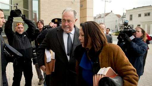 Pennsylvania Supreme Court Justice Michael Eakin, accompanied by his wife Heidi Eakin arrives for a hearing Monday, Dec. 21, 2015, at the Northampton County courthouse in Easton, Pa. to determine whether he should be suspended while a judicial ethics court decides if his email practices warrant discipline.