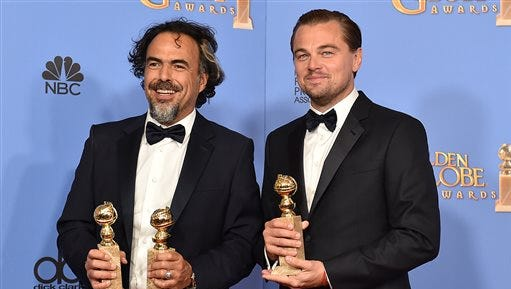 "Alejandro Gonzalez Inarritu, left, and Leonardo DiCaprio pose in the press room with the award for best motion picture - drama for ""The Revenant"" at the 73rd annual Golden Globe Awards on Sunday, Jan. 10, 2016, at the Beverly Hilton Hotel in Beverly Hills, Calif. (Photo by Jordan Strauss/Invision/AP)"