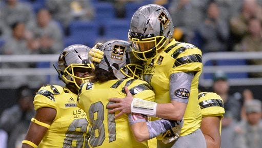 West wide receiver Simi Fehoko (81) celebrates a touchdown with West quarterback Shea Patterson during the first half of the Army All American Bowl high school football game. Patterson is a five-star recruit who is enrolling early at Ole Miss.