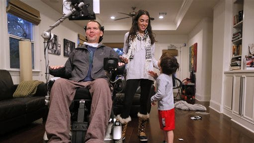 "In this Monday, Jan. 18, 2016, photo, former New Orleans Saints NFL football player Steve Gleason and his wife, Michel, pause to talk to their 4-year-old son, Rivers, during an interview in their home in New Orleans. ""GLEASON,"" a feature-length documentary that gives an unfiltered look at his life with ALS premieres at the Sundance Film Festival on Saturday. (AP Photo/Jonathan Bachman)"