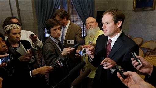 Rep. Jeremy Durham, R-Franklin, right, speaks with reporters following a House Republican caucus meeting on the opening day of the second session of the 109th General Assembly Tuesday, Jan. 12, 2016, in Nashville, Tenn.