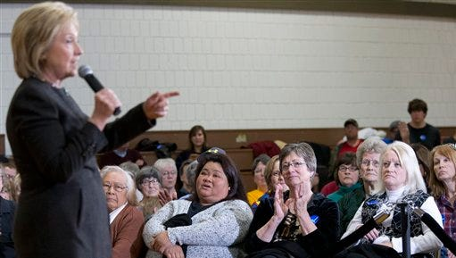 In this photo taken Jan. 25, 2016, supporters listen as Democratic presidential candidate Hillary Clinton speaks during a campaign event at the Knoxville School District Administration Office in Knoxville, Iowa.