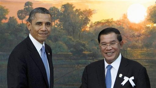 In this Nov. 19, 2012 file photo, President Barack Obama shakes hands with Cambodia's Prime Minister Hun Sen in Phnom Penh, Cambodia. When President Barack Obama welcomes Southeast Asian leaders for a shirt-sleeves summit in California this week, he'll have some interesting dining companions. There will be a coup leader with a penchant for song, a sultan with a taste for the high life and a ruthless prime minister with 31 years on the job.
