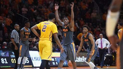 Tennessee forward Armani Moore (4) celebrates as the buzzer rings on Tennessee's 81-65 victory over LSU during an NCAA college basketball game in Knoxville, Tenn., on Saturday.