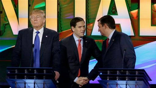Republican presidential candidate, businessman Donald Trump, pauses as Republican presidential candidate, Sen. Marco Rubio, R-Fla., center and Republican presidential candidate, Sen. Ted Cruz, R-Texas, greet at a break during a Republican presidential primary debate at The University of Houston, Thursday, Feb. 25, 2016, in Houston. (AP Photo/David J. Phillip)