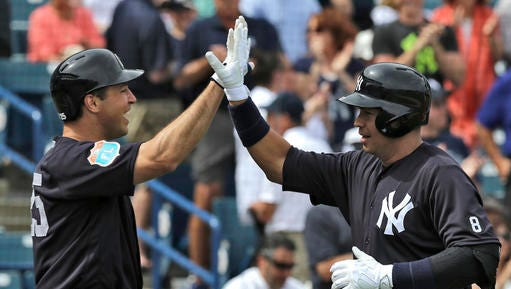 New York Yankees' Alex Rodriguez, right, high fives on-deck batter Mark Teixeira after hitting a two-run home run off Philadelphia Phillies starting pitcher Adam Morgan during the first inning of a spring training baseball game Thursday, March 3, 2016, in Tampa, Fla. Yankee's Carlos Beltran also scored. (AP Photo/Chris O'Meara)