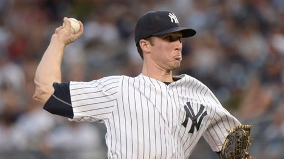 New York Yankees pitcher Bryan Mitchell delivers the