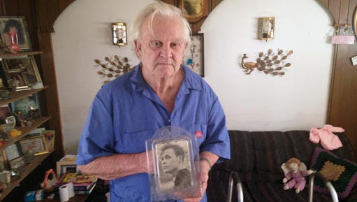 Pollock resident Donald Burke holds an old photograph of his brother-in-law, Charles Lee Johnson, who died in May 2013 following an altercation with a nursing assistant at a Department of Veterans Affairs medical center in Pineville. Johnson, an Air Force veteran, was 70 when he died. VA officials concluded that Johnson died in an accidental fall, but local prosecutors filed a manslaughter charge against the nursing assistant, Fredrick Kevin Harris.