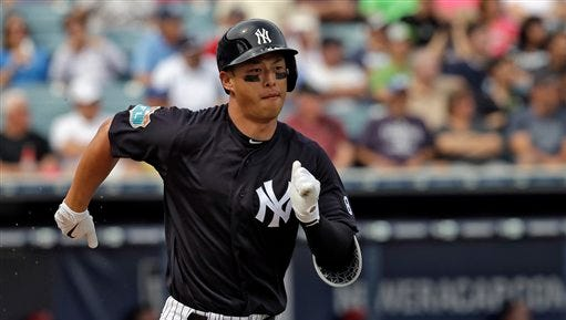 New York Yankees' Robert Refsnyder grounds out during the second inning of a spring training baseball game against the Philadelphia Phillies Thursday, March 3, 2016, in Tampa, Fla. (AP Photo/Chris O'Meara)