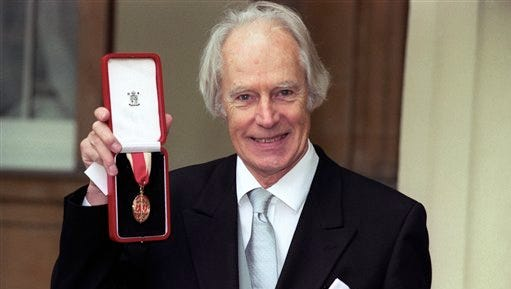 FILE - In this Nov. 12, 1996 file photo, Sir George Martin poses for the media with his knighthood at Buckingham Palace, London. George Martin, the Beatles' urbane producer who quietly guided the band's swift, historic transformation from rowdy club act to musical and cultural revolutionaries, has died, his management said Wednesday March 9, 2016. He was 90. (Neil Munns/PA via AP)