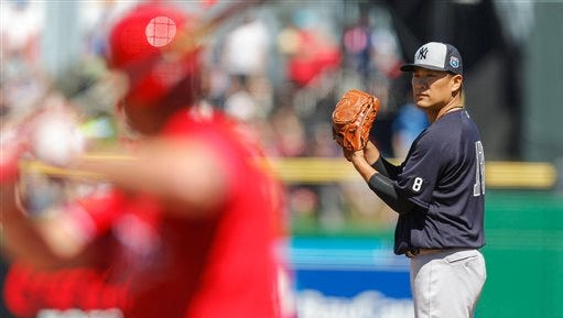 New York Yankees' Masahiro Tanaka prepares to throw during the second inning of a spring training baseball game against the Philadelphia Phillies on Sunday, March 6, 2016, in Clearwater, Fla. (AP Photo/Mike Carlson)