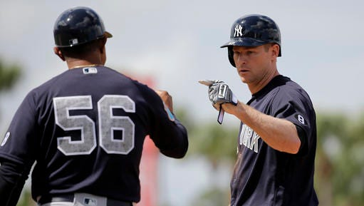 New York Yankees' Chase Headley, right, is congratulated by first base coach Tony Pena after hitting an RBI single during the third inning of an exhibition spring training baseball game against the New York Mets, Wednesday, March 9, 2016, in Port St. Lucie, Fla. (AP Photo/Jeff Roberson)