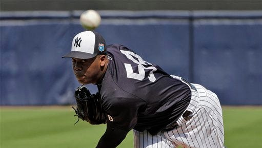 New York Yankees relief pitcher Aroldis Chapman warms up during a spring training baseball game against the Toronto Blue Jays Thursday, March 10, 2016, in Tampa, Fla. (AP Photo/Chris O'Meara)