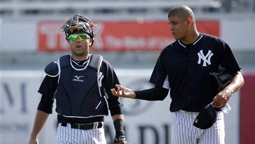 New York Yankees relief pitcher Dellin Betances, right, talks with catcher Austin Romine, left, during a spring training baseball workout, Monday, March 2, 2015, in Tampa, Fla.