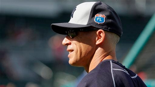 New York Yankees manager Joe Girardi (28) stands on the infield during batting practice before a spring training baseball game against the Boston Red Sox on Tuesday, March 15, 2016, in Fort Myers, Fla.
