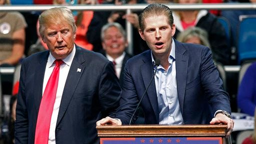 FILE - In this Jan. 2, 2016 file photo, Republican presidential candidate Donald Trump, left, listens as his son Eric Trump speaks during a rally in Biloxi, Miss. A law enforcement official says New York City police and the FBI are investigating a threatening letter sent to the Manhattan apartment of Eric Trump. The official says the envelope sent to Eric Trump's apartment on Thursday, March 17, 2016 contained a suspicious white powder and a threatening letter. There were no injuries and the official said preliminary tests indicated that the white substance was not hazardous. (AP Photo/Rogelio V. Solis)