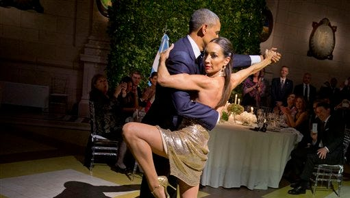 President Barack Obama does the tango with a dancer during the State Dinner at the Centro Cultural Kirchner, Wednesday, March 23, 2016, in Buenos Aires, Argentina.