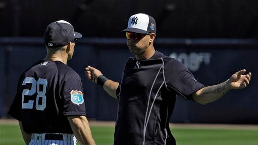 New York Yankees catcher Gary Sanchez, right, talks to manager Joe Girardi during a spring training baseball workout Friday, Feb. 19, 2016, in Tampa, Fla.