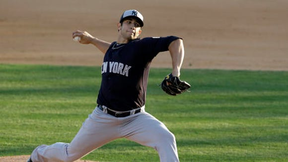 New York Yankees pitcher Luis Cessa throws against the Washington Nationals in the sixth inning of spring training baseball game, Wednesday, March 23, 2016, in Viera, Fla.