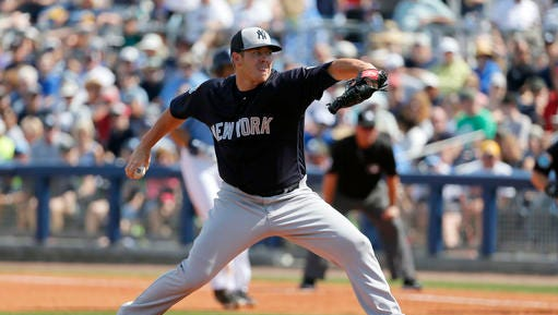 New York Yankees relief pitcher Johnny Barbato works against the Tampa Bay Rays in the fourth inning of a spring training baseball game, Saturday, March 12, 2016, in Port Charlotte, Fla. (AP Photo/Tony Gutierrez)