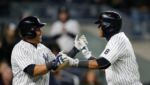 New York Yankees Carlos Beltran, left, greets the Yankees Starlin Castro at the plate after Castro hit a three-run, home run in the second inning of a baseball game against the Houston Astros in New York, Wednesday, April 6, 2016.