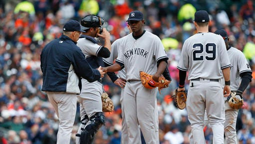 New York Yankees starting pitcher Luis Severino is relieved by New York Yankees manager Joe Girardi in the sixth inning of a baseball game, Friday, April 8, 2016, in Detroit.