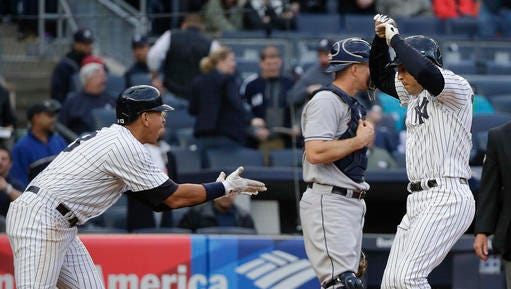 New York Yankees' Mark Teixeira, right, is greeted by Alex Rodriguez at the plate after hitting a three-run home run against the Houston Astros during the seventh inning of a baseball game, Thursday, April 7, 2016, in New York.