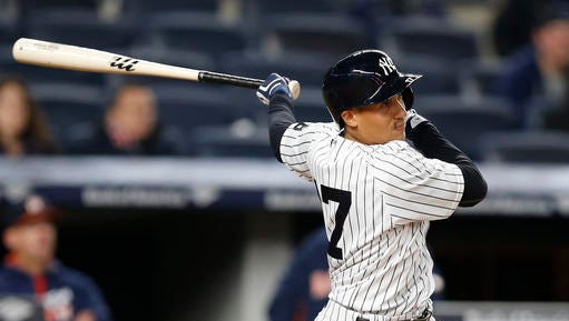 New York Yankees pinch hitter Ronald Torreyes follows through on his two-run triple in the seventh inning of a baseball game against the Houston Astros in New York, Wednesday, April 6, 2016.