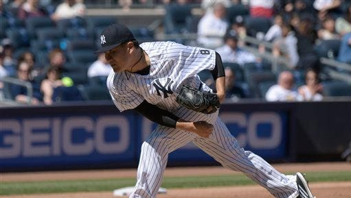 New York Yankees pitcher Masahiro Tanaka delivers the ball to the Seattle Mariners during the fifth inning of a baseball game Sunday, April 17, 2016, at Yankee Stadium in New York.