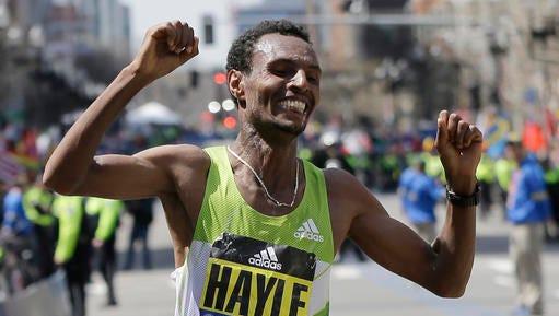 Lemi Berhanu Hayle, of Ethiopia, celebrates after winning the 120th Boston Marathon on Monday.