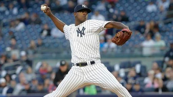 New York Yankees' Luis Severino delivers a pitch during the first inning of a baseball game against the Seattle Mariners on Friday, April 15, 2016, in New York.