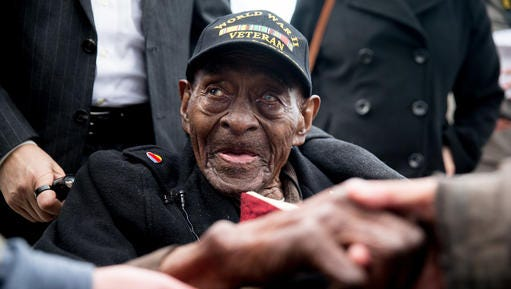 FILE - In this Dec. 7, 2015 file photo, Frank Levingston Jr., of Lake Charles, La.,  is greeted by visitors following a wreath laying ceremony to mark the anniversary of Pearl Harbor at the World War II Memorial in Washington.  Levingston, a 110-year-old veteran who served in World War II has died, on Tuesday, May 3, 2016.
