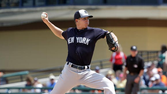 New York Yankees' Chad Green pitches against the Detroit Tigers in the third inning of a spring training baseball game, Thursday, March 31, 2016, in Lakeland, Fla.