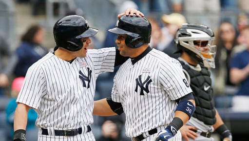 New York Yankees Jacoby Ellsbury, left, congratulates Yankees designated hitter Carlos Beltran (36) after he scored on Beltran's 400th career home run during the sixth inning of a baseball game against the Chicago White Sox in New York, Sunday, May 15, 2016.