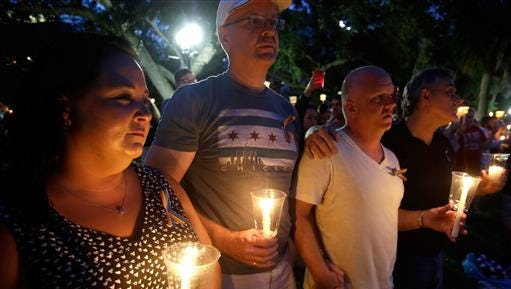 Supporters of the victims of the recent mass shooting at the Pulse nightclub attend a vigil at Lake Eola Park, Sunday, June 19, 2016, Orlando, Fla. Tens of thousands of people attended the vigil.