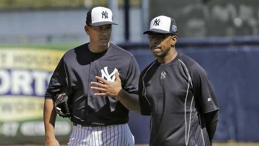 Yankees designated hitter Alex Rodriguez talks to spring training instructor Willie Randolph during batting practice on February 25, 2016.