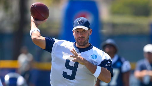 Dallas Cowboys quarterback Tony Romo passes the ball during practice at the NFL football team's training camp in Oxnard, Calif., Tuesday.