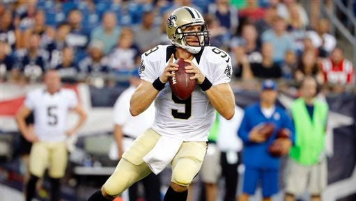 New Orleans Saints quarterback Drew Brees passes against the New England Patriots.
