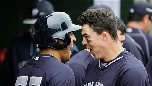 New York Yankees' Ramon Flores, left, celebrates with teammate Tyler Austin after Flores hit a home run in the sixth inning of an exhibition spring training baseball game against the Houston Astros, Saturday, March 7, 2015, in Kissimmee, Fla.