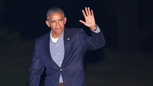 President Barack Obama waves to members of the media as he walks across the South Lawn of the White House in Washington, Friday, Sept. 9, 2016, during his return from nearby Andrews Air Force Base. Obama traveled to Asia this week and was returning from Laos after attending the ASEAN Summit. (AP Photo/Pablo Martinez Monsivais)