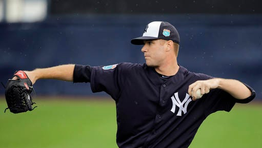 New York Yankees pitcher Tyler Webb throws in the outfield during a spring training baseball workout Wednesday, Feb. 24, 2016, in Tampa, Fla.