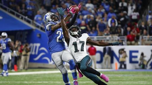 Detroit's Darius Slay intercepts a pass intended for the Eagles' Nelson Agholor late in the fourth quarter Sunday.